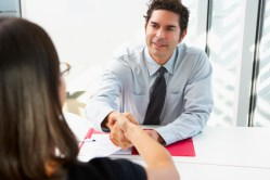 Businessman Interviewing Female Candidate For Job